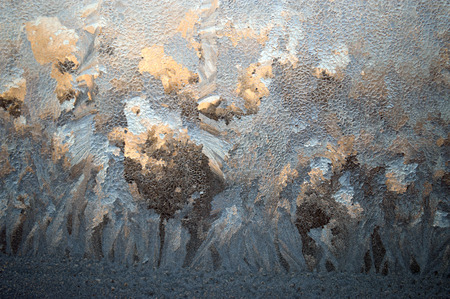 rising temperature: horizontal background frost on the window