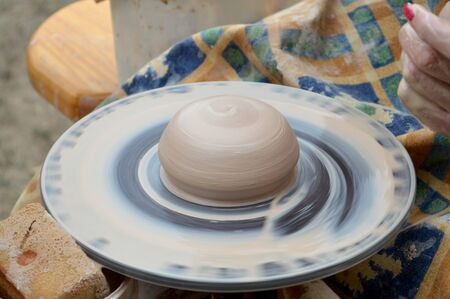 rotating pottery wheel with a piece of clay billet Stock Photo