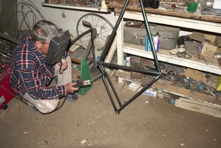 welder brews bicycle frame photo
