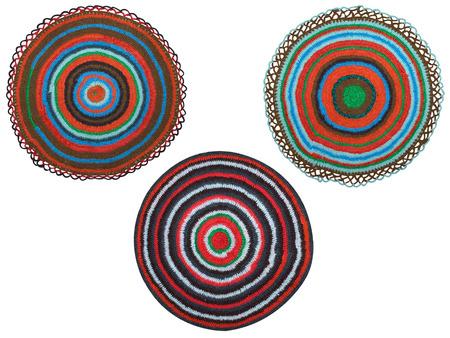 three handmade rug on a white background photo