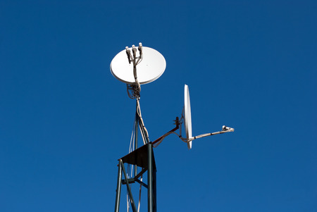 two satellite antenna mount and the blue sky photo