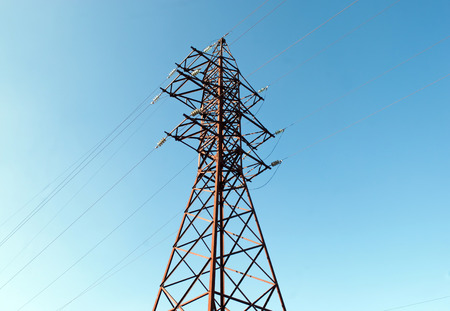 electricity supply: iron pole for electricity supply with wires and blue sky