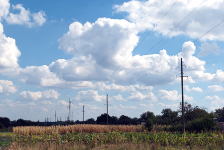 megawatts: poles for electricity supply on the background of clouds