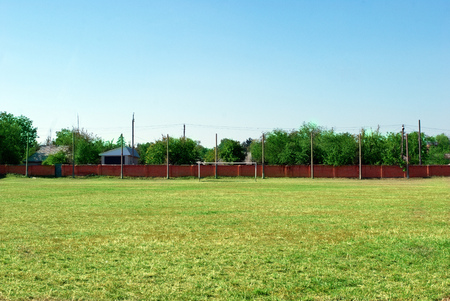 annotation: amateurish soccer field for football and recreation