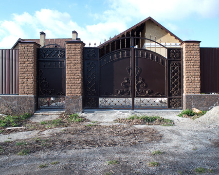iron fence: artistic wrought iron gate house roof