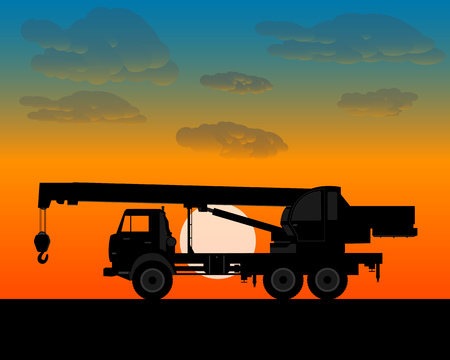 worth: truck crane for lifting is worth of building materials in the evening at sundown