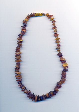 rosin: necklace with untreated of amber on a white background