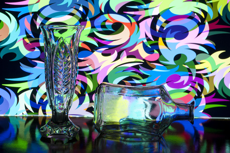 glass vase and bottle on a background of different patterns