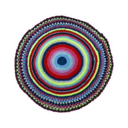 knitted round rug with multi-colored threads on a white background