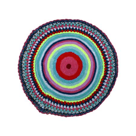knitted round rug for legs on a white background