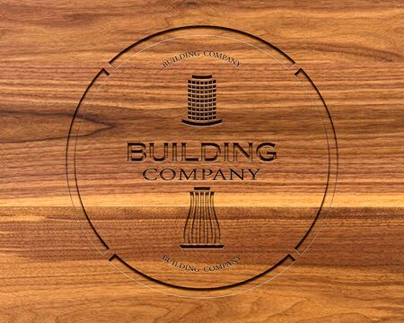 logo of a construction company with indented text on a brown board Stockfoto