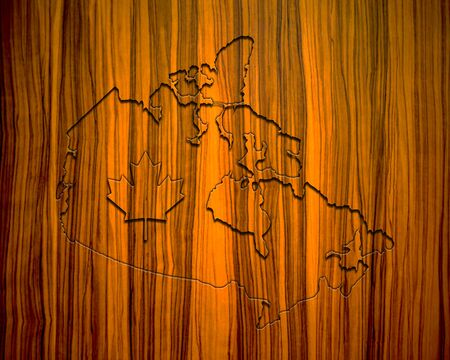 map of canada on brown blackboard with maple leaf symbol