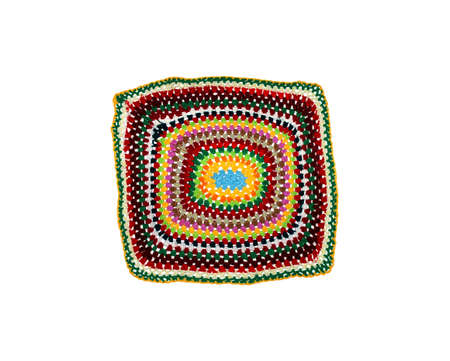 square knitted foot mat in different colors of thread on a white background Standard-Bild