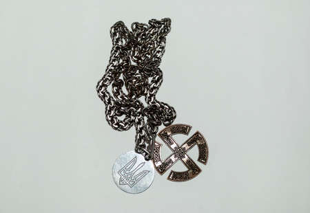 silver chain with trident medallions and Slavic sign Stockfoto