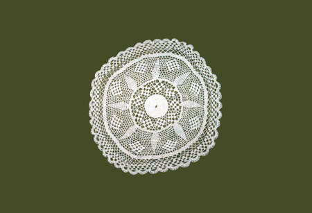 knitted napkin with white threads on a green background