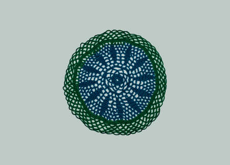 knitted napkin in different colors of threads in green and blue on a light background