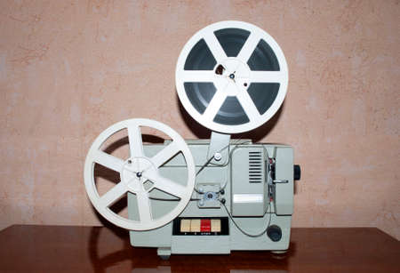 old movie projector and babies standing on the table Standard-Bild