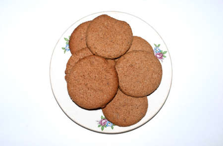homemade oatmeal cookies on a plate and white background
