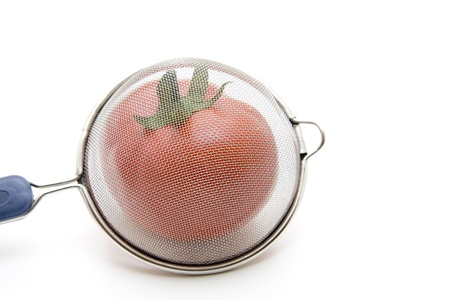 sieve: Household sieve with tomato