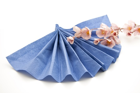 Blue paper napkin folded with flower
