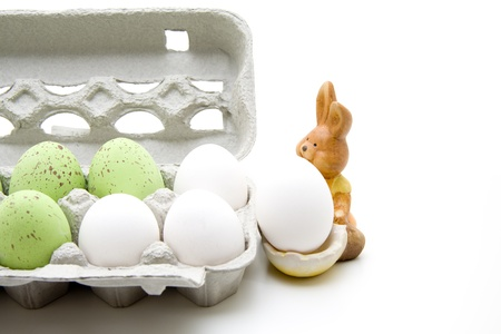 Eggs in the egg carton with easter bunny Stock Photo - 11374066