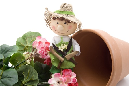 Straw doll with flowerpot photo