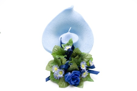 Light blue candle with bouquet photo