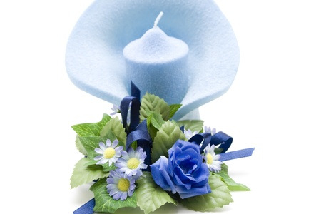 artificially: Light blue candle with bouquet