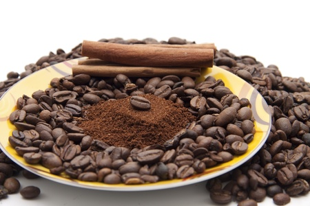 high spirited: Coffee beans on one under plate