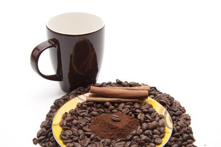 high spirited: Coffee beans with coffee mug
