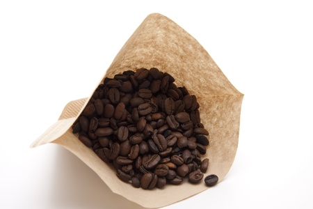 high spirited: Coffee beans in filter paper