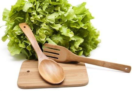endivia: Ensalada de endibias con un tenedor de madera