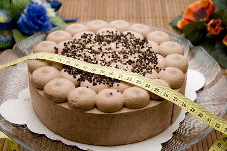 Cake with dimension tape photo