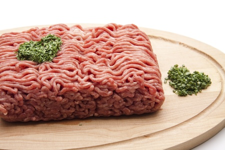 Wooden plate with mince and parsley
