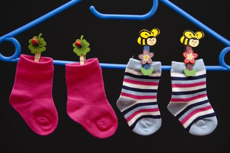 Baby socks on clothes hanger Stock Photo - 11943192