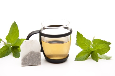 thirst quenching: Peppermint tea in the glass with tea bag Stock Photo