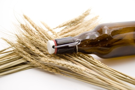 Wheat ear and glass bottle photo