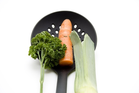 skimmer: Skimmer with carrots and leek Stock Photo