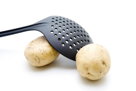 skimmer:  Potatoes under skimmer Stock Photo