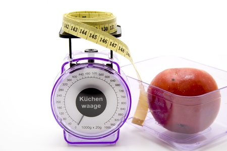 Kitchen scales with apple and dimension tape Stock Photo - 12078857