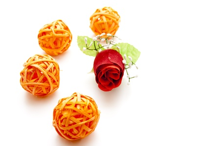 artificially:   Straw balls with rose bud