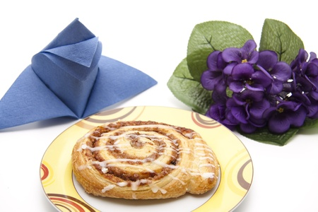 Coffee cake with napkin and flowers photo
