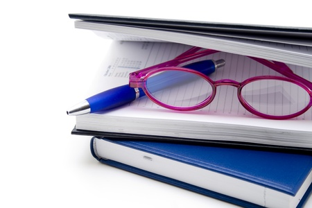 quoted: Notebook with reading glasses