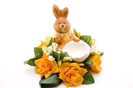 artificially: Easter bunny with rose flower arrangement