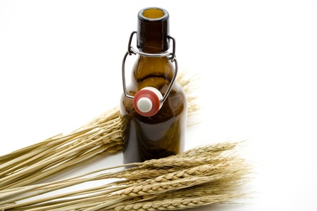 Beer bottle and wheat ear photo