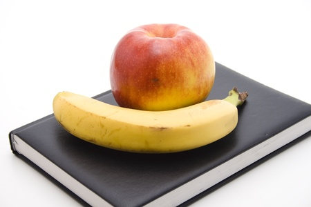 calories poor: Bananas with notebook and nectarine