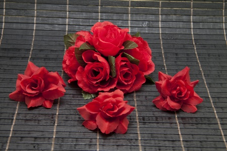 artificially: Rose flower arrangement with black background