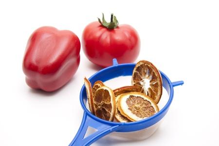 Culinary sieve with slice of orange Stock Photo - 12520392
