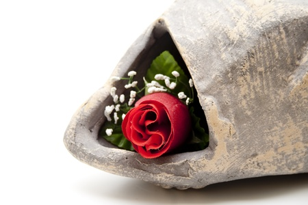 artificially: Rose in stone vase