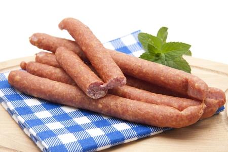Salami sausage on checked napkin